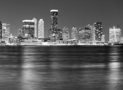 Black and white picture of Jersey City skyline at night.