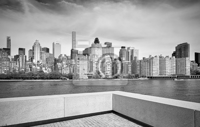 Black and white picture of Manhattan skyline seen from Roosevelt Island, New York City, USA.
