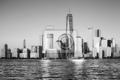 Black and white picture of New York City skyline at sunset, USA.