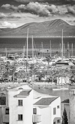 Black and white picture of Port of Alcudia, main tourist center in the North of Majorca, Spain.