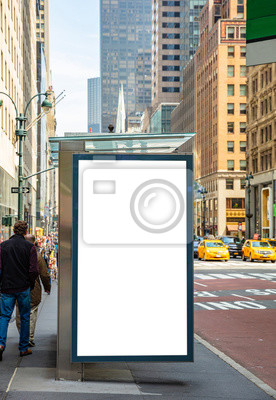 Obraz Blank billboard at bus stop for advertising, New York city buildings and street background