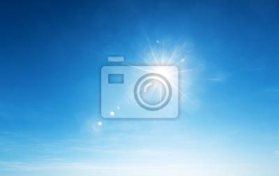 Obraz błękitne niebo i słońce