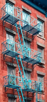 Blue fire escape at Manhattan old residential building, New York City, USA.