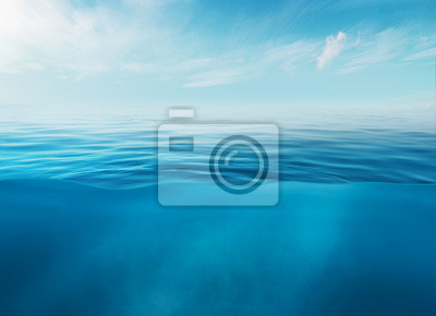 Obraz Blue sea or ocean water surface and underwater with sunny and cloudy sky
