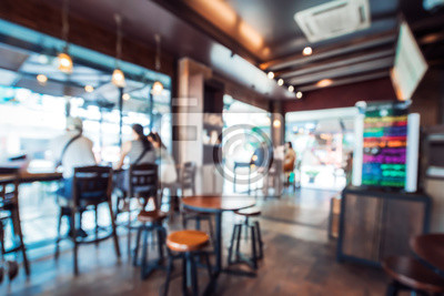 Obraz Blurred background image of coffee shop. abstract blur background with people in cafe. vintage color tone style