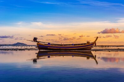 Boat and sea sunset or sunrise with colorful of sky and cloud in twilight