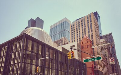 Broadway and Fulton street, color toned picture of New York diverse architecture, USA.