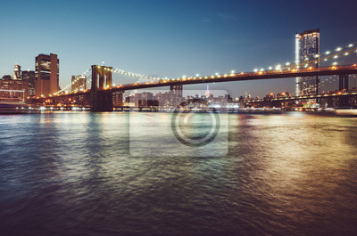 Brooklyn Bridge at blue hour, color toned picture, New York City, USA.
