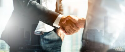 Obraz Businessman handshake for teamwork of business merger and acquisition,successful negotiate,hand shake,two businessman shake hand with partner to celebration partnership and business deal concept