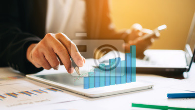 Obraz businessman investment consultant analyzing company financial report balance sheet statement working with digital graphs. Concept picture for stock market, office, tax,and project. 3D illustration.