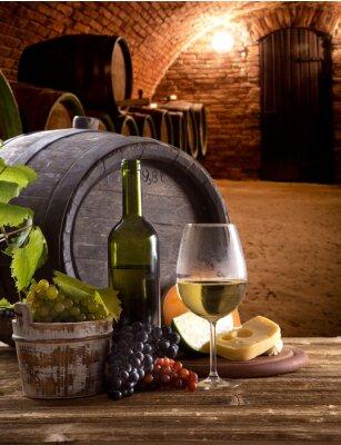 Obraz Butelka wina i szklanki na drewnianych tabeli