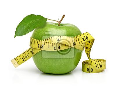 Obraz Cały zielony jabłko z pomiarową taśmą odizolowywającą na białym tle