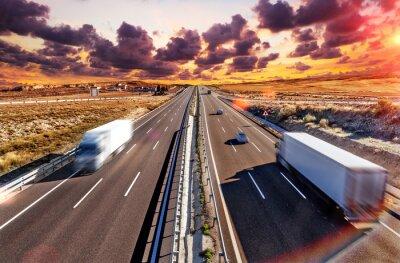 Obraz Camiones y autovia.Transporte internacional y logistica.Mercancia llegando a su destino por carretera. Industria del transporte