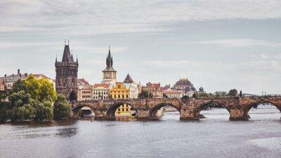 Charles Bridge, Prague famous landmark, color toning applied, Czech Republic.