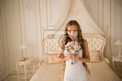 Obraz charming beautiful bride holding wedding bouquet in her hands