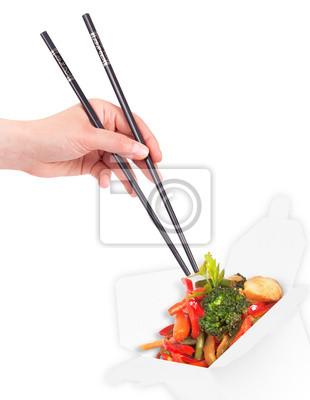 Chińskie jedzenie z ręki i pałeczki