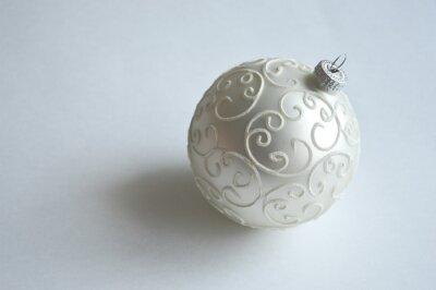 Obraz Christmas tree ball on a light background. Beautiful white ball on the Christmas tree. Preparation for the New year and Christmas. With the Christmas holiday.