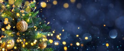 Obraz Christmas Tree In Blue Night - Golden Balls On Fir Branches With Defocused Lights In Abstract Background