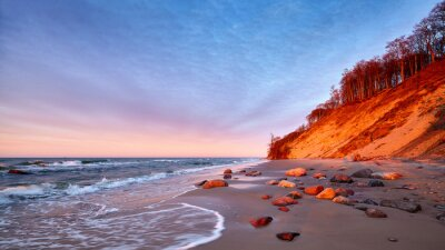 Cliff at a beach in Wolin National Park at sunset, Poland.