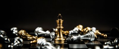 Obraz Close up king chess standing winner to fighting challenge battle on chess board concepts of leadership and business strategy and human personal organization risk management.