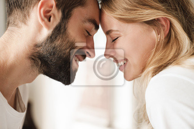 Obraz Close up of a beautiful happy young couple relaxing