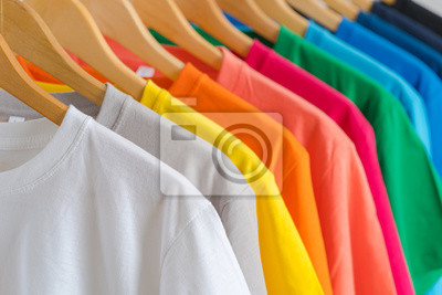 Obraz Close up of Colorful t-shirts on hangers, apparel background
