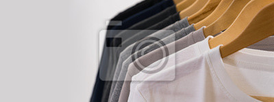 Obraz Close up of T-shirts on hangers, apparel background