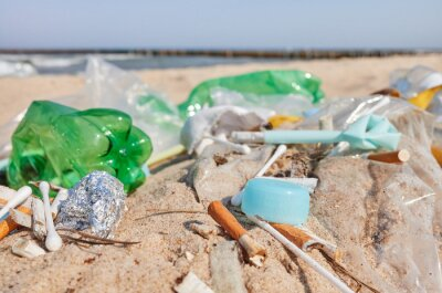 Close up picture of garbage left on a beach, selective focus.