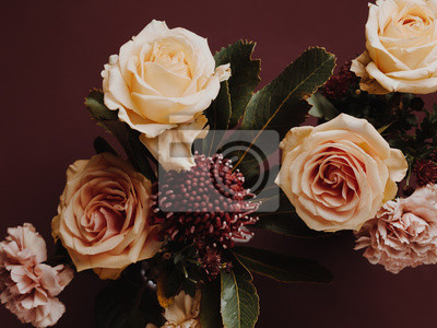 Obraz Close up shot of floral arrangement in autumn colours with roses, carnations and protea