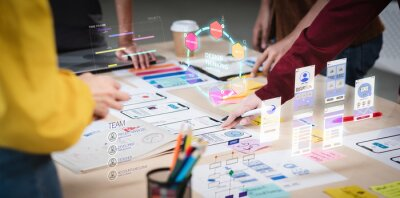 Obraz Close up ux developer and ui designer use augmented reality brainstorming about mobile app interface wireframe design on desk at modern office.Creative digital development agency