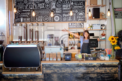 Obraz Coffee shop is open - woman at workplace at new open café.