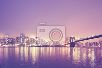Color toned picture of the Manhattan at a foggy night, New York City, USA.