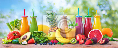 Obraz Colorful freshly squeezed fruits and vegetables smoothies with ingredients for healthy eating