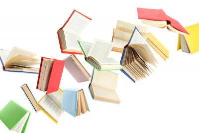 Obraz Colorful hardcover books flying on white background