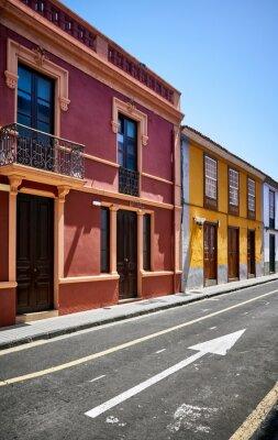 Colorful houses by a street in San Cristobal de La Laguna old town, Tenerife, Spain.