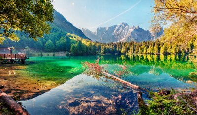 Obraz Colorful summer view of Fusine lake. Bright morning scene of Julian Alps with Mangart peak on background, Province of Udine, Italy, Europe. Traveling concept background.