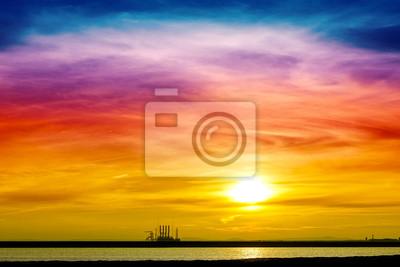 Colorful sunrise over harbor.