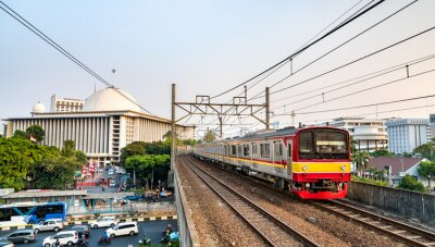 Commuter train near Istiqlal Mosque in Jakarta, the capital of Indonesia