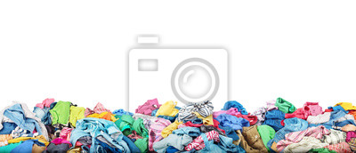 Obraz Concept of sale. Big pile of clothes on a white background. Donation