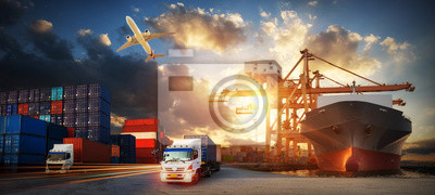 Obraz Container truck in ship port for business Logistics and transportation of Container Cargo ship and Cargo plane with working crane bridge in shipyard at sunrise, logistic import export and transport