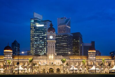 Contrast between modern office buildings and the famous Sultan Abdul Sama building in Kuala Lumpur, Malyasia capital city