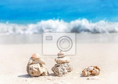 Coral pyramids on beach, Zen spa concept background.