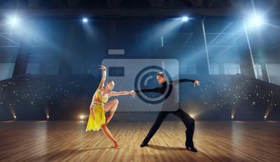 Obraz Couple dancers  perform latin dance on large professional stage. Ballroom dancing.