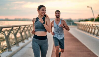 Obraz Couple doing sport on the street