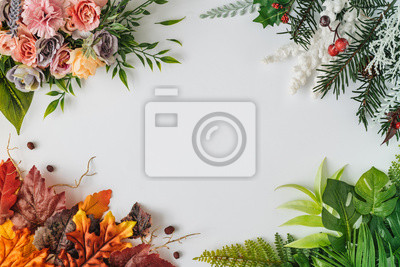 Obraz Creative season layout of colorful summer, spring, autumn and winter leaves and flowers. Nature mockup background. Seasonal concept. Flat lay