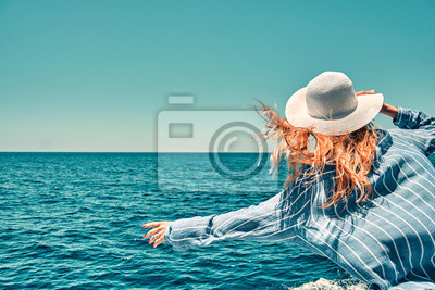 Obraz Cruise ship vacation woman enjoying travel vacation at sea. Free carefree happy girl travel at ocean or sea. Woman on a yacht enjoying the beautiful vacation.