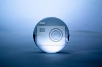 Obraz Crystal glass ball sphere transparent on blue gradient background.