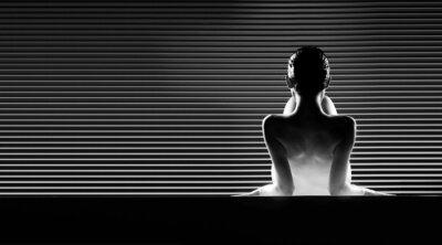 Obraz czarno-biały widok z tyłu artystyczne nago, na tle rozłożony .