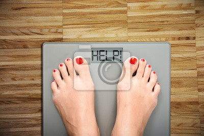 Obraz Czas rozpocząć dietę kobiecych stóp w skali mówiąc POMOC