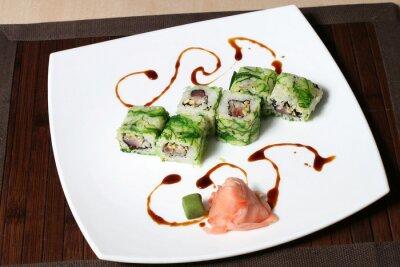 Obraz Część sushi na dużej białej płytce
